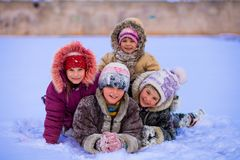 Funny children playing and laughing on snowy winter royalty free stock photo