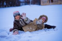 Funny children playing and laughing on snowy winter stock photo