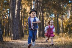 Funny kids playing in the park. Funny children are playing in the park. A boy and a girl. Carefree childhood Stock Photography