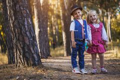 Funny kids playing in the park. Funny children are playing in the park. A boy and a girl. Carefree childhood Stock Image