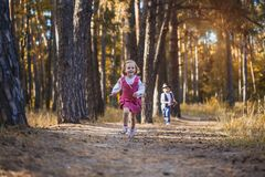 Funny kids playing in the park. Funny children are playing in the park. A boy and a girl. Carefree childhood Royalty Free Stock Images