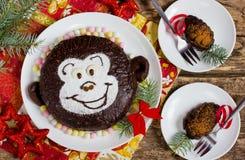 Funny children`s cake monkey and chocolate pinecones Stock Image