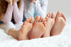 Funny children's foots is barefoot, closeup. This is the concept of friendship, trust and serenity Royalty Free Stock Image