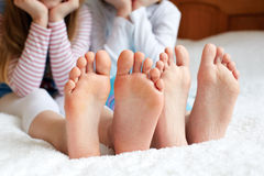 Funny children's foots is barefoot, closeup. This is the concept of friendship, trust and serenity Stock Image