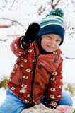 Funny children playing outside in winter season. Funny children saying hello to you Stock Photos