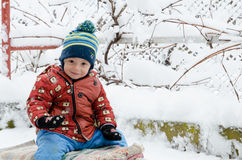 Funny children playing outside in winter season. Funny children saying hello to you Royalty Free Stock Photo