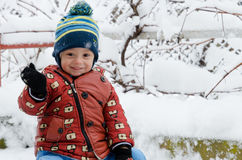Funny children playing outside in winter season. Funny children saying hello to you Royalty Free Stock Photography