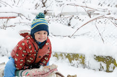 funny children playing outside in winter season  Stock Image