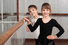 Children standing at ballet barre Stock Photo