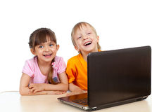 Funny children using a laptop royalty free stock photos