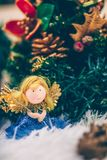 Funny christmas angel toy under the christmas tree. stock photo
