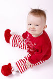 Funny Christmas baby sitting and laughing Stock Photos