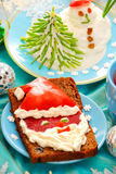 Funny christmas breakfast for child Stock Photos