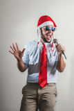 Funny christmas business man singing Stock Photo