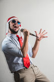 Funny christmas business man singing Royalty Free Stock Photo