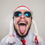 Funny christmas business man singing Royalty Free Stock Photography