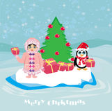 Funny Christmas card - a penguin and a small Eskimo Royalty Free Stock Image
