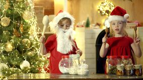 Funny Christmas chilren. Surprise kids with drum. Funny Merry Christmas and happy New Year. Crazy kids drummers. Excited. Children to drum with funny emotions stock video footage