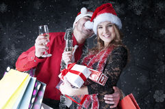 Funny Christmas couple with glasses of champagne Royalty Free Stock Images