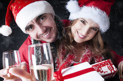 Funny Christmas couple with glasses of champagne Royalty Free Stock Photos