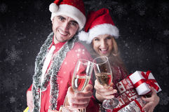 Funny Christmas couple with glasses of champagne Royalty Free Stock Image