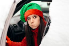 Funny Christmas Girl Driving Through the Snow on Bad Weather royalty free stock photos