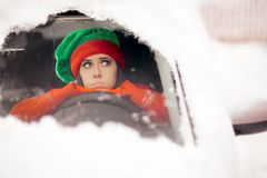 Funny Christmas Girl Driving Through the Snow on Bad Weather royalty free stock photo