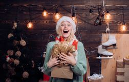 Funny christmas girl. Funny girl in santa clause costume. Euphoria. Cute young woman with santa hat. Crazy. True. Emotions. Beautiful Woman with christmas box stock photos