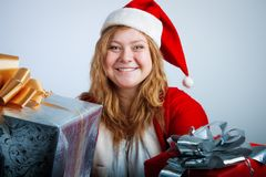 Funny christmas girl with gifts Stock Photo