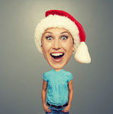 Funny christmas girl in red hat. Over grey background Royalty Free Stock Photos