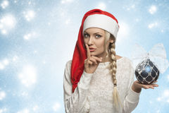 Funny christmas girl with red hat Stock Images