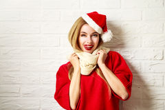 Funny Christmas Girl in Red Winter Clothes Royalty Free Stock Photography