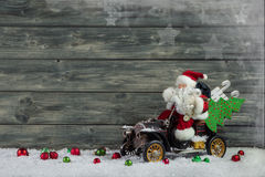 Funny christmas greeting card with santa claus and xmas presents Royalty Free Stock Images