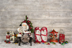 Funny christmas greeting card with santa and old children toys o Royalty Free Stock Images