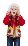 Funny Christmas little girl with Santa hat Stock Photos
