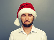 Funny christmas man in red hat over grey Stock Images