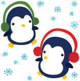 Funny Christmas Penguins. Two Funny Christmas Penguins wearing Ear Muffs Royalty Free Stock Photography