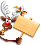 Funny Christmas Reindeer Cartoon holding Wooden Pa Stock Photo