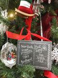 Funny Christmas signs to Santa Take Brother. Funny Christmas sign / post card to Santa on Christmas tree: Dear Santa leave presents take brother royalty free stock photography