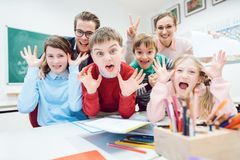 Funny class, students and teachers making faces stock image
