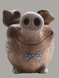 Funny clay piggy bank. Front view Stock Photo