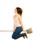 Funny cleaning woman with mop flying Stock Image