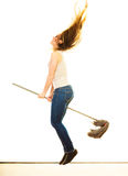 Funny cleaning woman with mop flying Royalty Free Stock Image