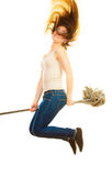 Funny cleaning woman with mop flying Royalty Free Stock Photography