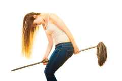 Funny cleaning woman with mop flying Stock Photography