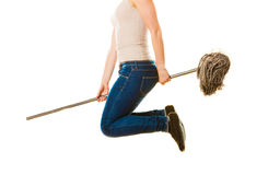 Funny cleaning woman with mop flying Royalty Free Stock Photo