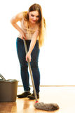 Funny cleaning woman mopping floor Stock Photo