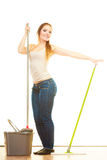 Funny cleaning woman mopping floor. Cleanup housework concept. Funny cleaning girl young woman mopping floor, holding two mops new and old white background Royalty Free Stock Photos