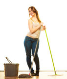 Funny cleaning woman mopping floor. Cleanup housework concept. Funny cleaning girl young woman mopping floor, holding two mops new and old white background Stock Photo