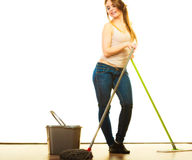 Funny cleaning woman mopping floor. Cleanup housework concept. Funny cleaning girl young woman mopping floor, holding two mops new and old white background Stock Photography